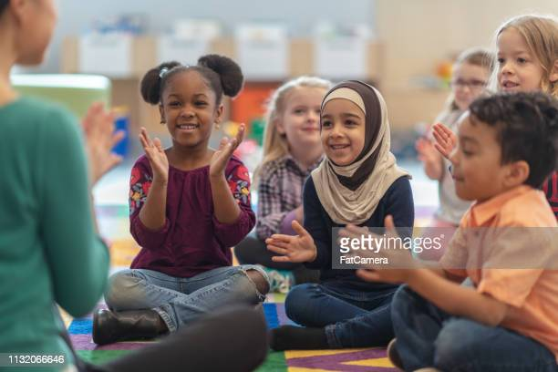 clapping along - elementary school stock pictures, royalty-free photos & images