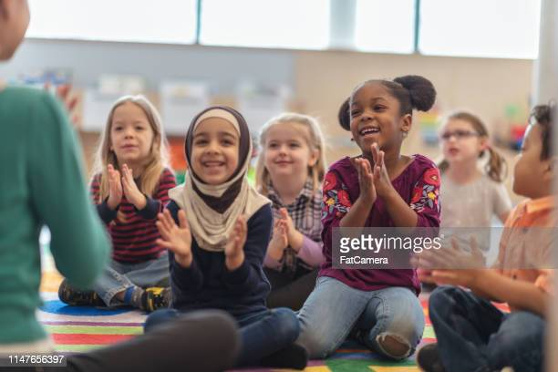 clapping along - clapping hands stock pictures, royalty-free photos & images