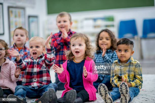clapping to a song - preschool building stock pictures, royalty-free photos & images