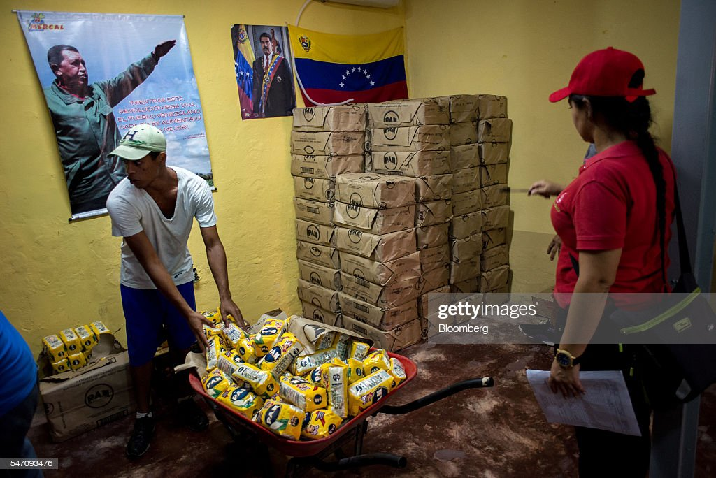 CLAPs members sort groceries for delivery in the Catia neighborhood on the outskirts of Caracas, Venezuela, on Saturday, July 2, 2016. In an attempt to regain control, President Nicolas Maduro has tapped loyal neighborhood groups, called Local Committees for Supply and Production (CLAPs), and put them in charge of distributing as much as 70 percent of the nation's food. Photographer: Manaure Quintero/Bloomberg via Getty Images