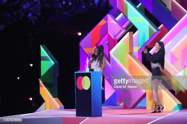 Clara Amfo and Maya Jama speak at The BRIT Awards 2021 at The O2 Arena on May 11, 2021 in London, England.
