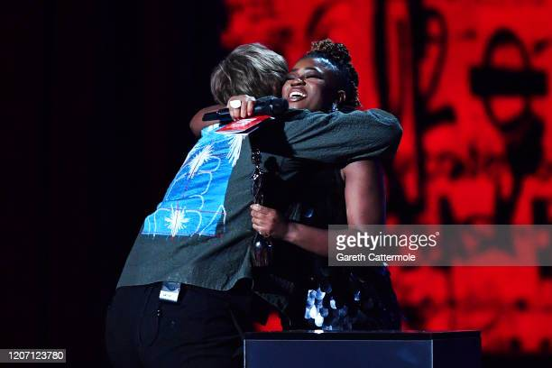 Clara Amfo hugs Lewis Capaldi after he wins the Best New Artist award during The BRIT Awards 2020 at The O2 Arena on February 18 2020 in London...