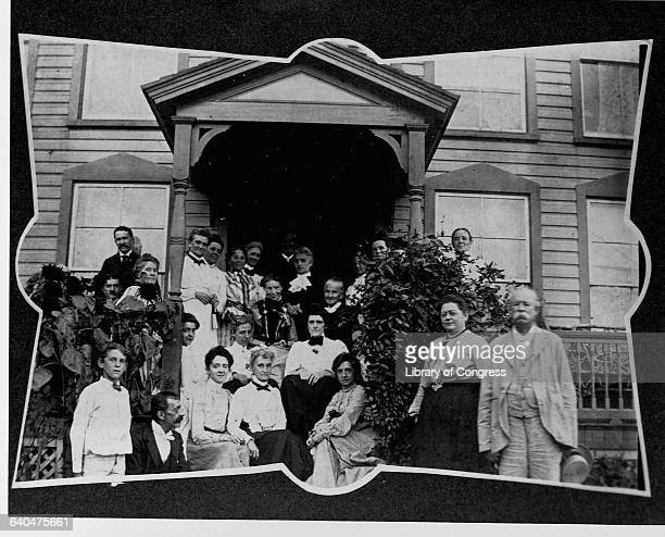 Clara Barton and Mrs Rich seated on porch of Clara Barton house Glen Echo Md surrounded by oth