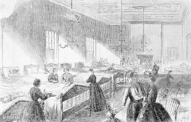 Clara Barton founder of the American Red Cross is seen in this woodcut supervising nurses in Washington Red Cross Hospital