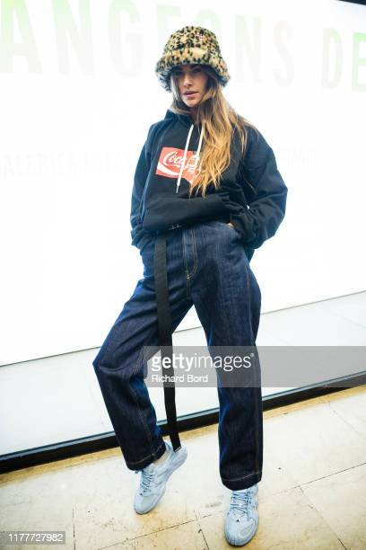 Clara Berry attends the Diesel X Coca Cola Womenswear Spring/Summer 2020 show at Galeries Lafayette as part of Paris Fashion Week on September 28...