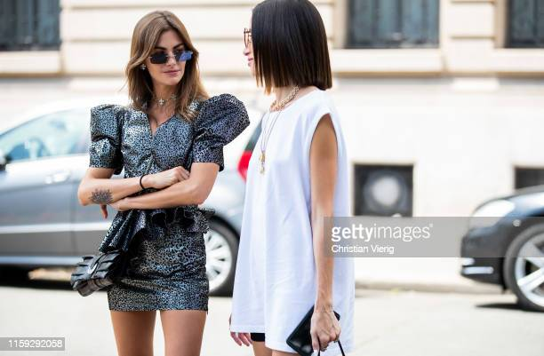 Clara Berry is seen wearing grey dress and Alexandra Guerain wearing white sleeveless dress outside Redemption during Paris Fashion Week Haute...