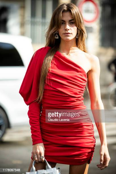 Clara Berry, wearing a red mini dress, is seen outside the Redemption show during Paris Fashion Week - Womenswear Spring Summer 2020 on September 26,...