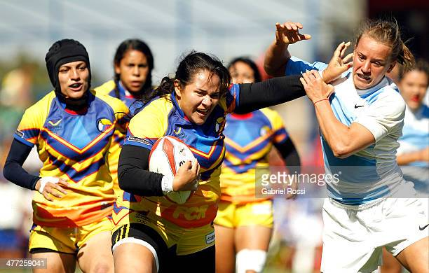 Clara Betancur of Colombia fights for the ball with Yamila Otero of Argentina during women's rugby qualifiers during day two of the X South American...