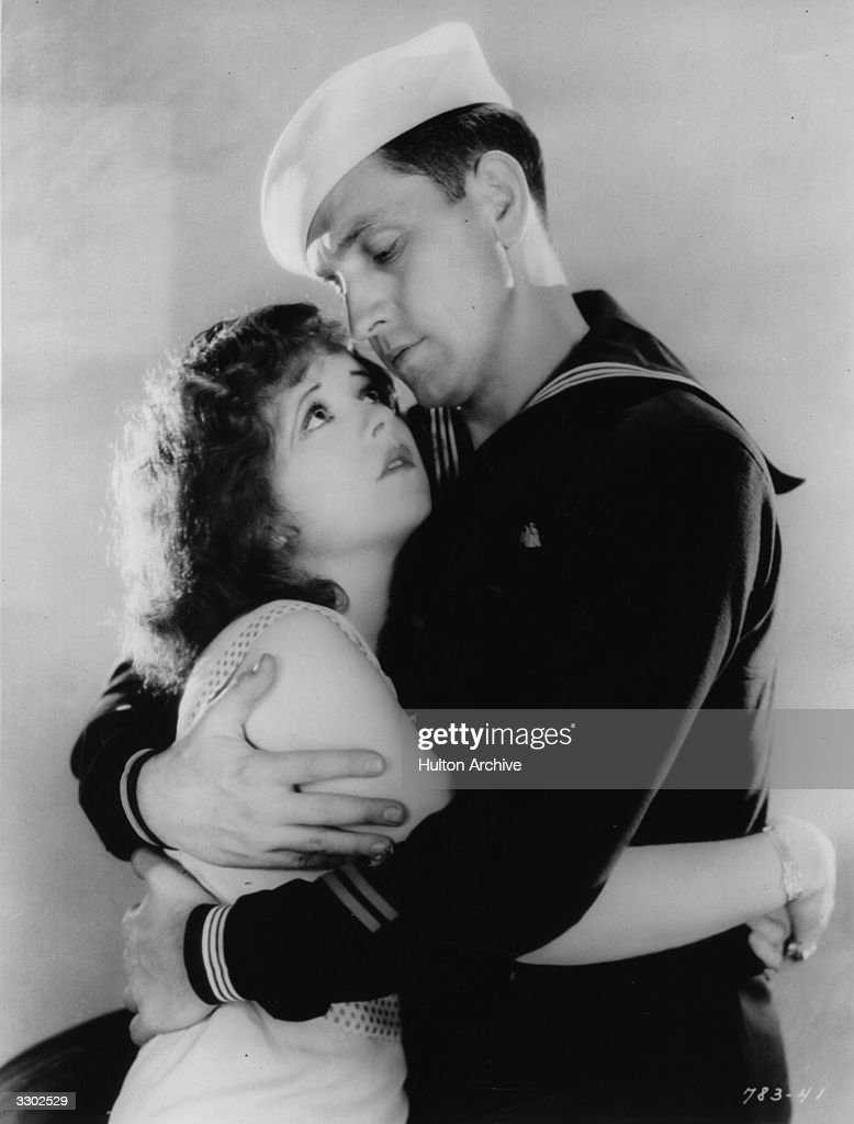 Clara Bow (1905 - 1965) the American leading lady and Fredric March (1897 - 1975) formerly Frederick McIntyre Bickel, in a scene from the film 'True To The Navy', about a drug store girl and her many sailor friends. The film was directed by Frank Tuttle for Paramount.