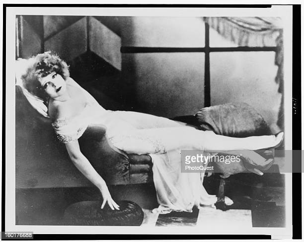 Clara Bow the 'It' girl reclining on a chaise late 1910s or early 1920s