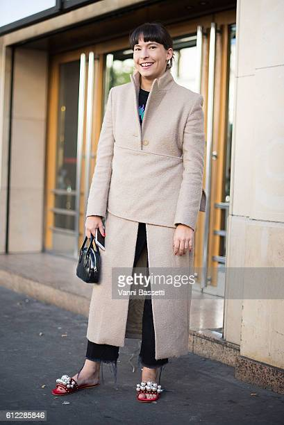 Clara Cornet poses after the Olympia Le Tan show at the Rex Club during Paris Fashion Week Womenswear SS17 on October 3 2016 in Paris France