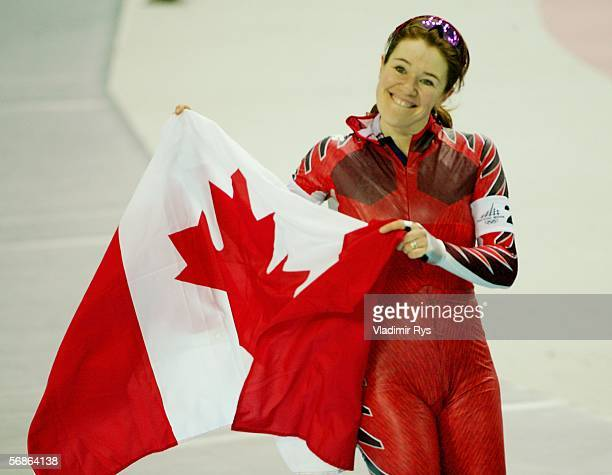Clara Hughes of Canada celebrates her team winning the silver medal with a time of 30291 in the speed skating team pursuit during Day 6 of the Turin...