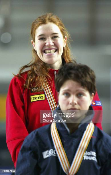 Clara Hughes of Canada smiles on the podium after winning Ladies 5000 metres event with Gretha Smit of Netherlands at the World Single Distance Speed...