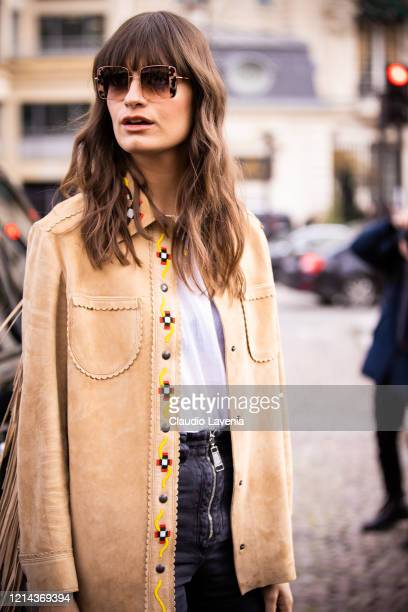 Clara Luciani, wearing a beige fringed jacket, is seen outside Miu Miu, during Paris Fashion Week - Womenswear Fall/Winter 2020/2021 : Day Nine on...