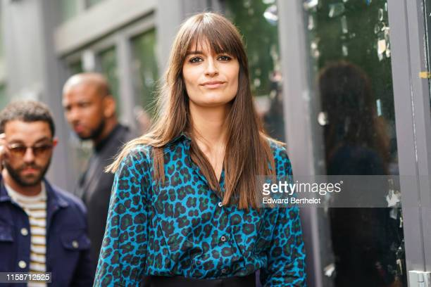 Clara Luciani wears a leopard print blue green and black dress outside Paul Smith during Paris Fashion Week Menswear Spring/Summer 2020 on June 23...