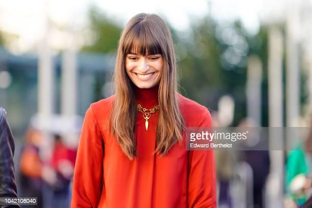Clara Luciani wears an orange dress and a burgundy Chloe bag outside Chloe during Paris Fashion Week Womenswear Spring/Summer 2019 on September 27...