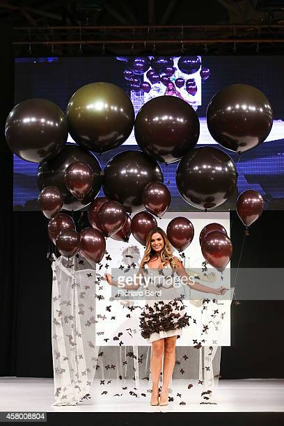 Clara Morgane walks the runway and wears a chocolate dress made by designer Fanny Liautard and chocolate maker Henry Le Roux during the Fashion...