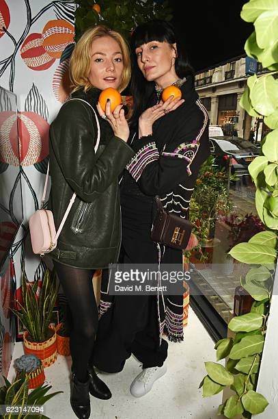Clara Paget and Erin O'Connor take part in the Cointreau project at Liberty London on November 14 2016 in London England