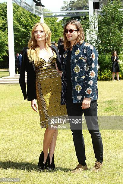 Clara Paget and Oscar Tuttiett arrive at Burberry Menswear Spring/Summer 2016 show at Kensington Gardens on June 15 2015 in London England
