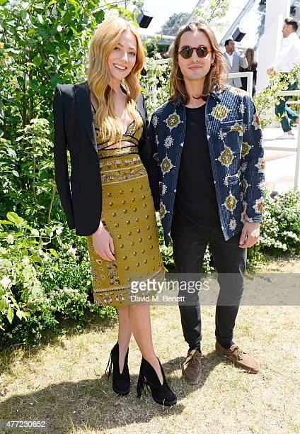 Clara Paget and Oscar Tuttiett arrive at the Burberry Menswear Spring/Summer 2016 show at Kensington Gardens on June 15 2015 in London England