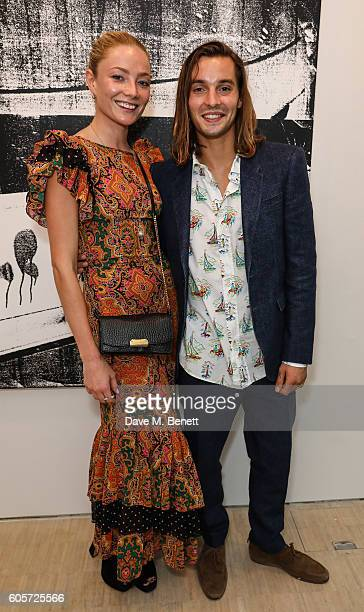 Clara Paget and Oscar Tuttiett attend a private view of 'Stutter' a new exhibition by Kingsley Ifill at The Cob Gallery on September 14 2016 in...