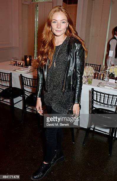 Clara Paget attends the FRAME Denim dinner hosted by Hanneli Mustaparta at Il Bottaccio on May 28 2014 in London England