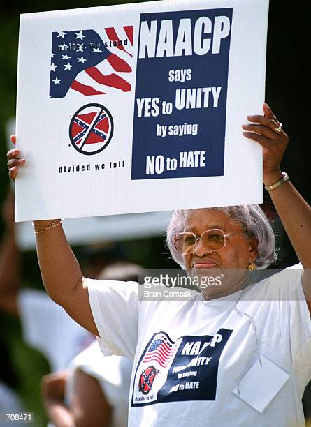 Clara Polite of GA holds a sign during a protest April 19 2002 in Fort Mill SC The NAACP called for an economic boycott of the state due to South...