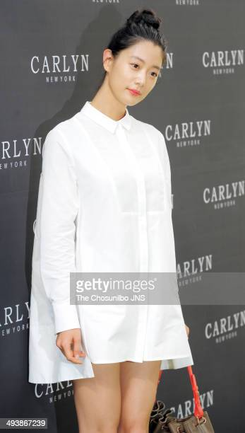 Clara poses for photographs during the CARLYN launching event at SongEun ArtSpace on May 22 2014 in Seoul South Korea