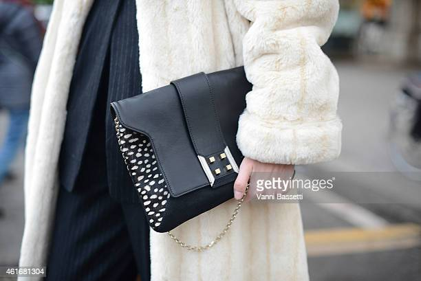Clara Racz poses wearing a vintage outfit and Manurina clutch on January 17 2015 in Milan Italy