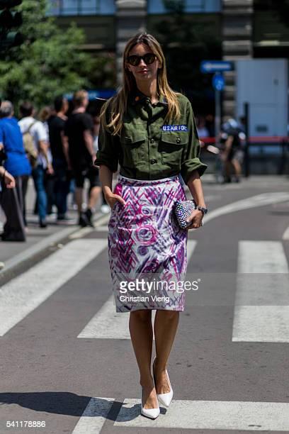 Clara Racz wearing an olive military button shirt outside Jil Sander during the Milan Men's Fashion Week Spring/Summer 2017 on June 18 2016 in Milan...