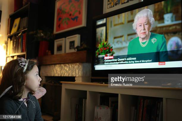 Clara Ruscio, aged 5 who is the photographer's daughter, watches from home as Queen Elizabeth II addresses the nation in a special broadcast to the...