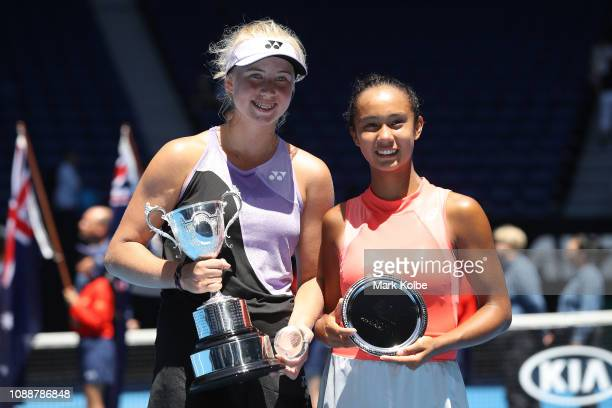 Clara Tauson of Denmark and Leylah Annie Fernandez of Canada pose after their Junior Girls' Singles Final during day 13 of the 2019 Australian Open...