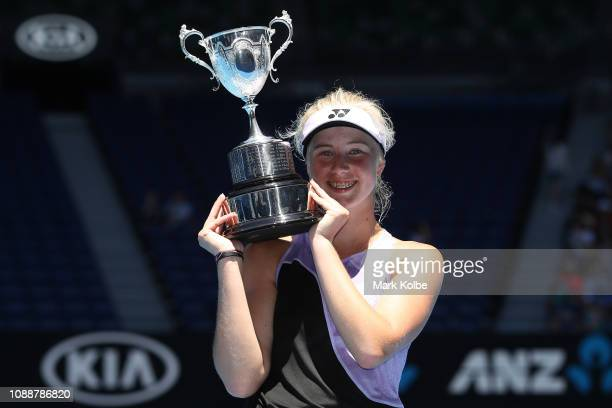Clara Tauson of Denmark poses with the championship trophy after winning her Junior Girls' Singles Final against Leylah Annie Fernandez of Canada...