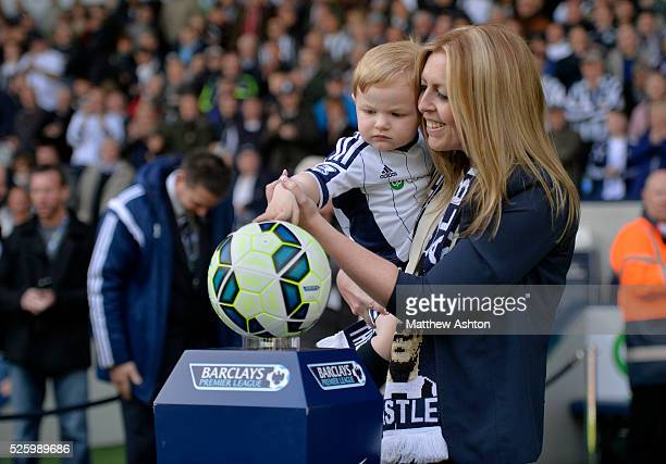 Clare Astle daughter of Jeff Astle and Jeffs grandson Joseph place the match ball onto the plinth on Jeff Astle Day celebrating the former WBA legend...