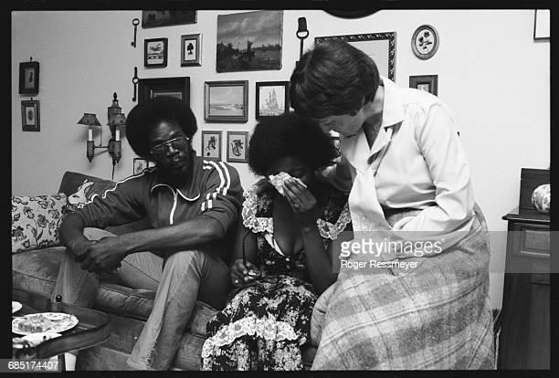 Clare Bouquet comforts Deborah Grant, who lost her sister Claudia in the Jonestown massacre. Bouquet knew U.S. Representative Leo Ryan who was also...