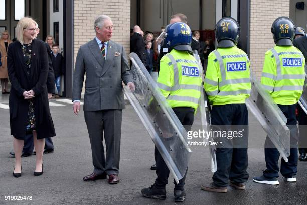Clare Crabb North Regional Director for the Prince's Trust lookson as The Prince of Wales meets students following a fire and public order...