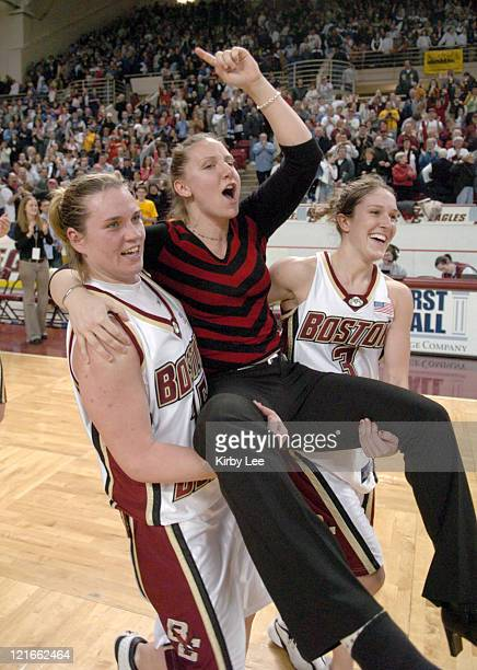 Clare Droesch and Sarah Marshall of Boston College carry injured leading scorer Jessalyn Deveny who is out for the season with a torn right Achille's...