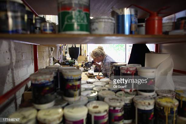 Clare Grotefeld a Senior Prop Maker at Glyndebourne opera house works on a prop before a production of the Benjamin Britten opera 'Billy Budd' on...