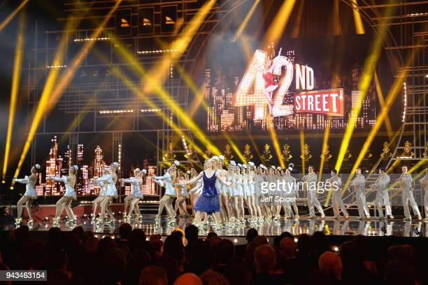 Clare Halse and the cast of 42nd Street perform on stage during The Olivier Awards with Mastercard at Royal Albert Hall on April 8 2018 in London...