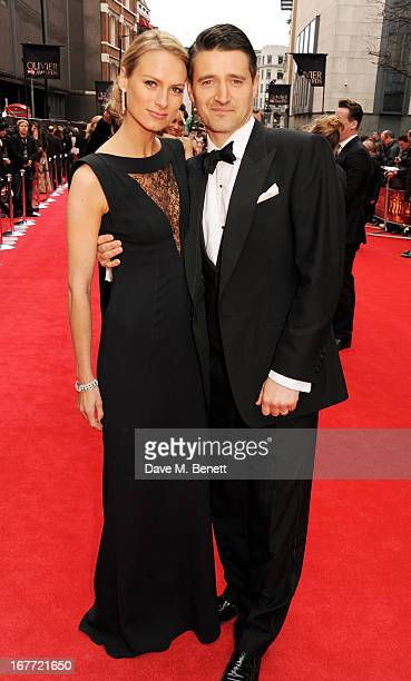 Clare Harding and Tom Chambers arrive at The Laurence Olivier Awards 2013 at The Royal Opera House on April 28, 2013 in London, England.