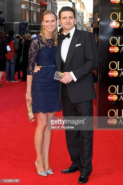 Clare Harding and Tom Chambers arrives at the Olivier Awards at The Royal Opera House on April 15, 2012 in London, England.