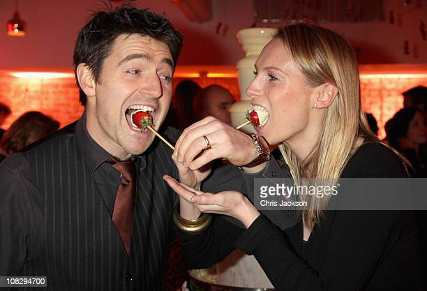 Clare Harding and Tom Chambers attend the 'Thorntons Celebrate 100 Years' party at Shoreditch House on January 24, 2011 in London, England.