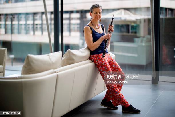 Clare Hoskins, a freelance oboist, poses for a photograph in central London on March 20, 2020. - UK freelance musicians, among the vulnerable...
