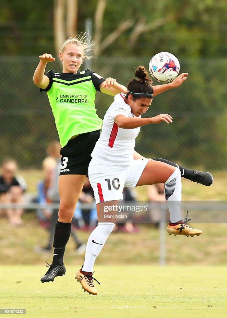 Clare Hunt of Canberra and Lee Flakon of the Wanderers contest possession during the round 11 W-League match between Canberra United and the Western Sydney Wanderers at McKellar Park on January 14, 2018 in Canberra, Australia.