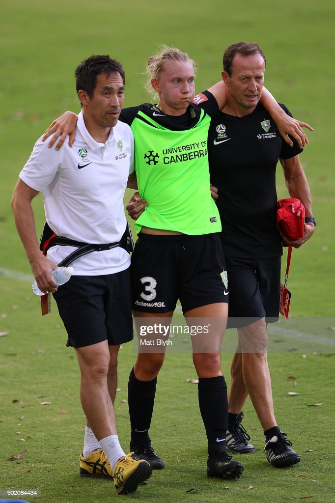 Clare Hunt of Canberra United FC is helped off the field by trainers during the round 10 W-League match between Canberra United and Adelaide United at McKellar Park on January 7, 2018 in Canberra, Australia.