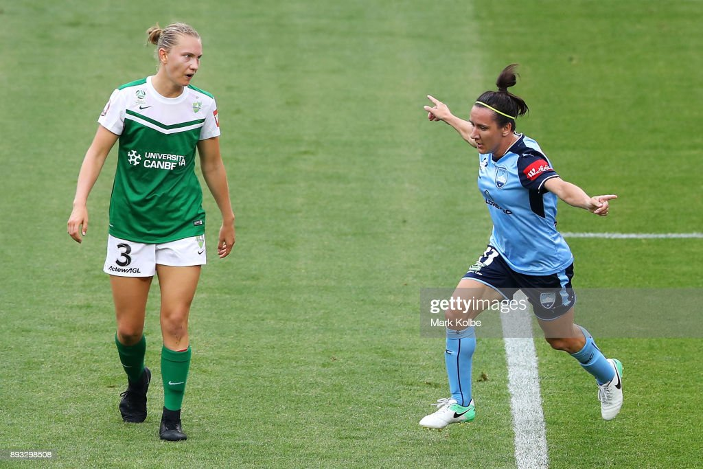 Clare Hunt of Canberra United looks dejected as Lisa De Vanna of Sydney FC celebrates scoring a goal during the round eight W-League match between Sydney FC and Canberra United at Allianz Stadium on December 15, 2017 in Sydney, Australia.