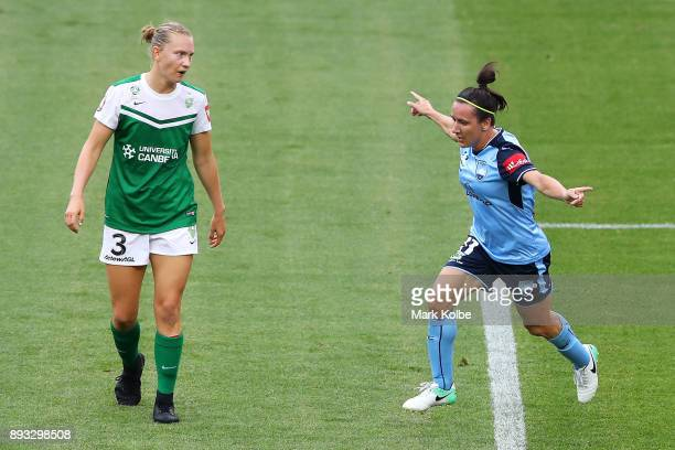 Clare Hunt of Canberra United looks dejected as Lisa De Vanna of Sydney FC celebrates scoring a goal during the round eight WLeague match between...