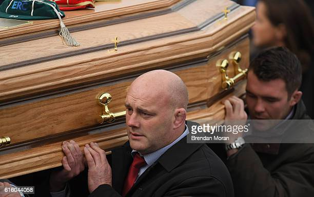 Clare , Ireland - 21 October 2016; Former Munster player John Hayes and Munster captain Peter O'Mahony carry the coffin of Munster Rugby head coach...