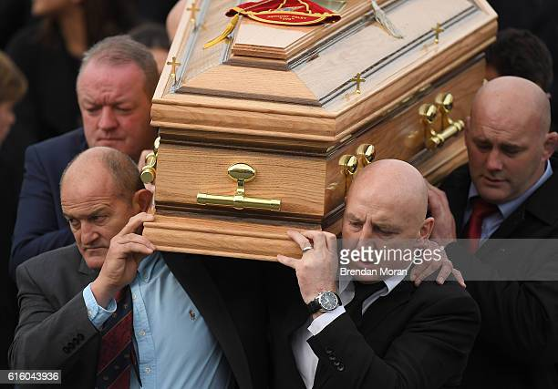 Clare Ireland 21 October 2016 Former Munster players from left Mick Galwey Peter Clohessy Keith Wood and John Hayes carry the coffin of Munster Rugby...