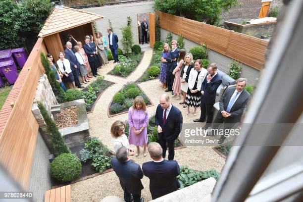 Clare Milford Haven introduces the The Duke of Cambridge to guests in the garden during a visit to James' Place in Liverpool on June 19 2018 in...